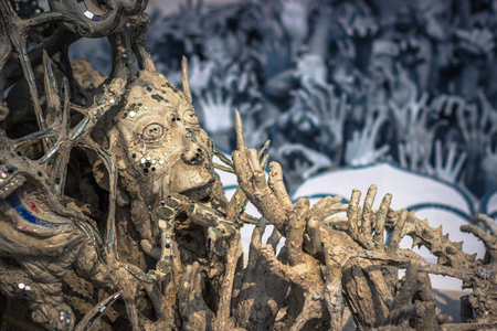 Chiang Rai - October 18, 2014: Sculptures of hands in the white temple of Wat Rong Khun in Chiang Rai, Thailand Editorial