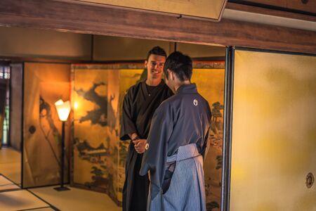Kyoto - May 29, 2019: Iaido sensei and western student inside a Samurai house in Kyoto, Japan