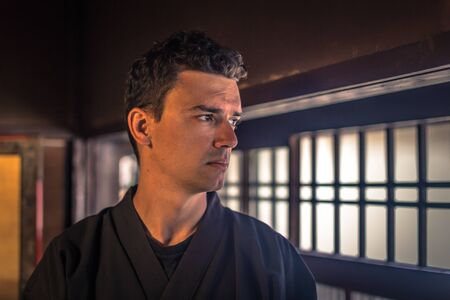 Kyoto - May 29, 2019: Western traveler inside a Samurai house in a Samurai Experience event in Kyoto, Japan Stock Photo - 127300239