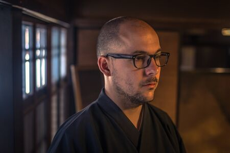 Kyoto - May 29, 2019: Western traveler inside a Samurai house in a Samurai Experience event in Kyoto, Japan Editorial