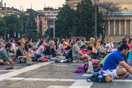 Budapest - June 21, 2019: Yoga event at dawn in Heroes Square in Budapest, Hungary
