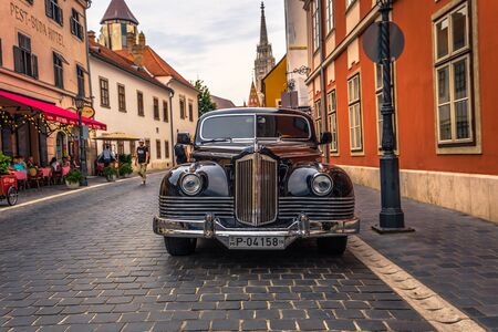 Budapest - June 22, 2019: Classic black car on the Buda side of Budapest, Hungary