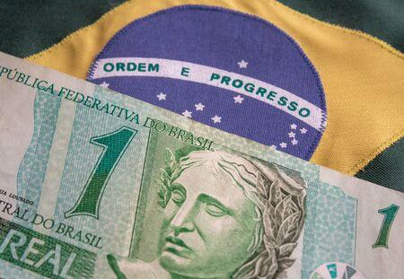 US dollar bill and Brazilian reais banknotes, business finance exchange market. 写真素材