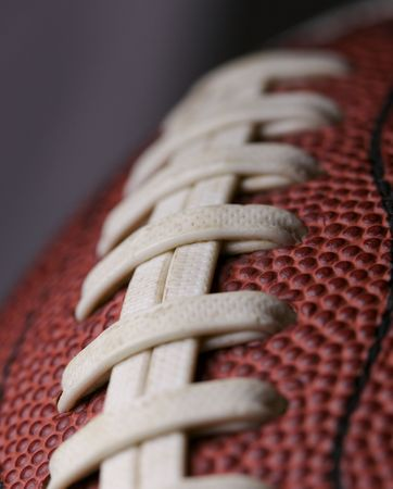 Football close up with shallow depth of field and focus on second seam
