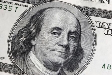 One Hundred Dollar Bill with Close Up on Ben Franklin