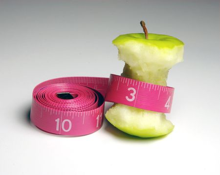 Apple with Tape measure isolated on white Grey background Stock Photo