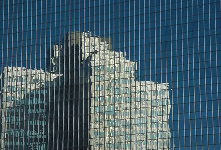Building reflection of the glass of another building Stock Photo