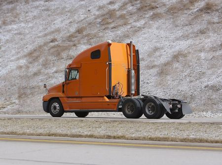 Orange Semi Truck on Highway without Trailer