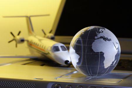 Globe on laptop Stock Photo