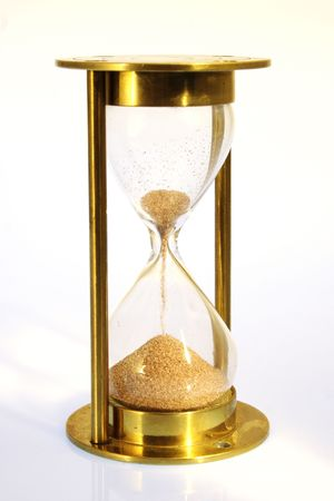Hourglass counting the time is running out Stock Photo