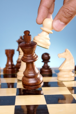 checkmate: A game of chess comes to an end. The king is checkmated.