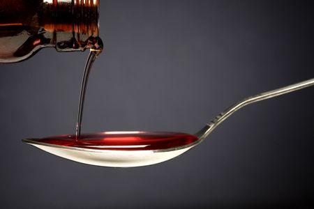 Cough Medicine and Spoon  Фото со стока