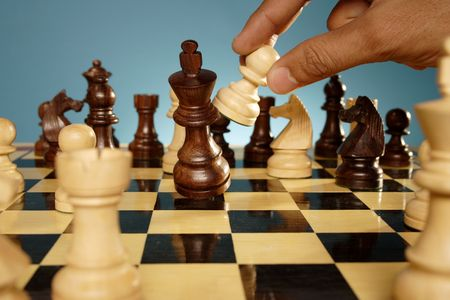 pawn to king: A game of chess comes to an end. The king is checkmated
