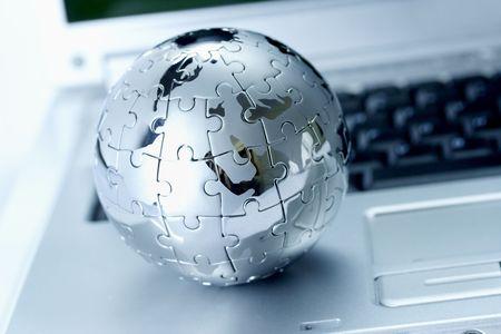Globe puzzle on laptop