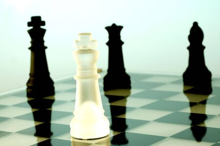 adversary: A game of chess comes to an end. The king is checkmated.