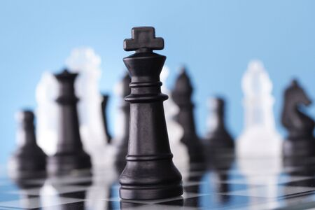risky: A game of chess comes to an end. The king is checkmated.