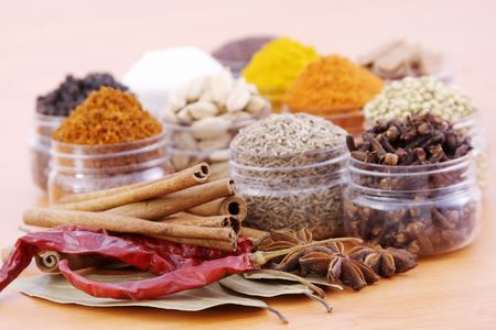 Verity of spices in plastic containers.