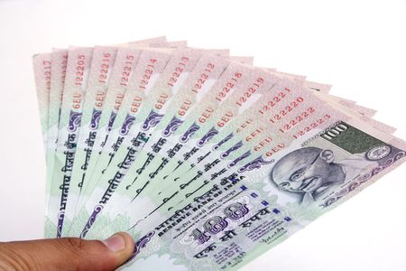rupees: Holding Indian currency notes on white