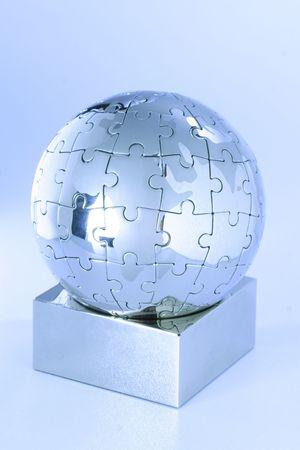 Globe puzzle  showing the world Stock Photo