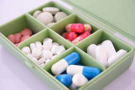Pills and capsules in medicine box Stock Photo