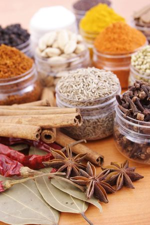 Assorted spices in plastci containers Stock Photo