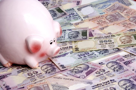 Piggy bank and Indian currency
