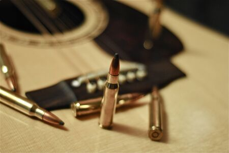 Bullets on an acoustic guitar.