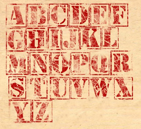c a w: A very destroyed looking set of letters on a parchment background. Can be used as a font. All 26 letters of the alphabet have been destroyed. Stock Photo