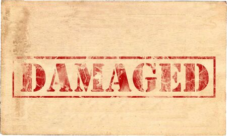damaged: The word Damaged, printed in red ink on parchment, destroyed, damaged, and faded. Stock Photo