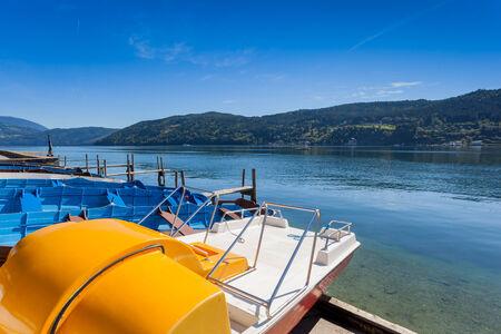 View of the alpine lake of Millstatt  witn paddle boats. Millstatt am See, Carinthia, Austria photo