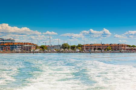 The seaside town of Grado provinces of Gorizia seen from the lagoon on a sunny summer day. Friuli Venezia Giulia, Italy.