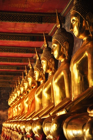 golden buddhist sculpture in thailand photo