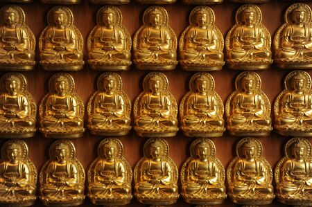 golden buddhist sculpture on wooden wall Stock Photo - 12430731