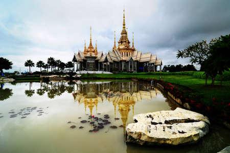 thai church with pond reflection photo
