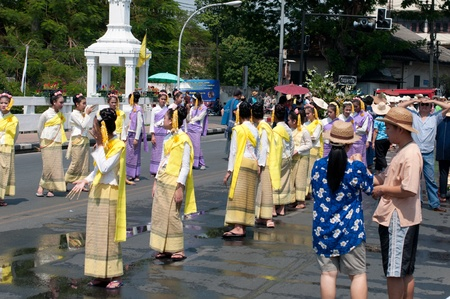 CHIANG MAI, THAILAND - APRIL 13:Undentified beautiful with traditionally dressed woman in parade on Songkran Festival on April 13, 2012 in Chiang Mai, Thailand