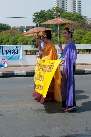 nawarat bridge: CHIANG MAI, THAILAND - APRIL 13 Undentified beautiful with traditionally dressed woman in parade on Songkran Festival on April 13, 2012 in Chiang Mai, Thailand  Editorial