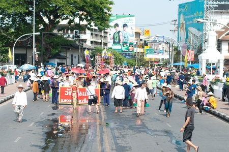 CHIANG MAI, THAILAND - APRIL 13 Undentified beautiful with traditionally dressed woman in parade on Songkran Festival on April 13, 2012 in Chiang Mai, Thailand  Stock Photo - 13387090