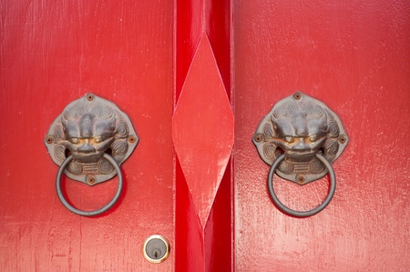 Door knob with red casement door Stock Photo - 13629377