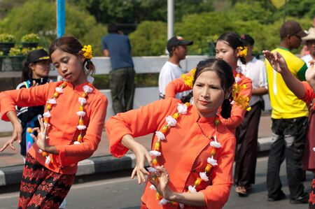 nawarat bridge: CHIANG MAI, THAILAND - APRIL 13:Undentified beautiful with traditionally dressed woman in parade on Songkran Festival on April 13, 2012 in Chiang Mai, Thailand