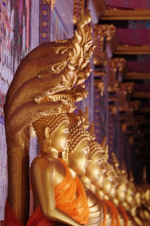 veneration: Golden buddhist statue in Thai art style, Thailand Stock Photo