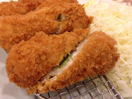 grid: tongkatsu delicious fried pork with salad in japanese style Stock Photo