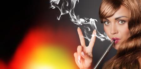 handsign: peaceful woman smokes her vape pen