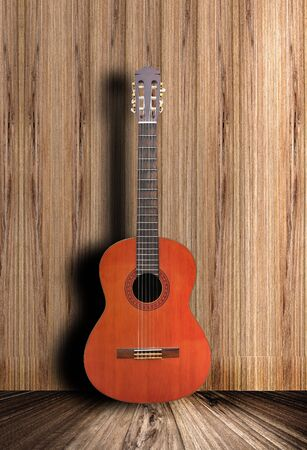 Acoustic guitar with wooden background photo