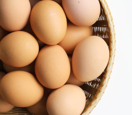 eggs in the basket on white  photo