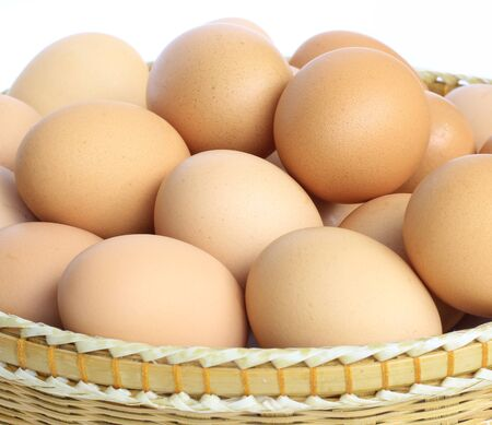 eggs in the basket on white Stock Photo - 11473482