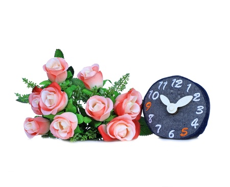 Denim clock  with rose bouquet isolate on white background photo