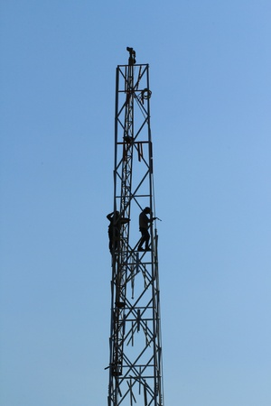 transference: Two men building communications Tower