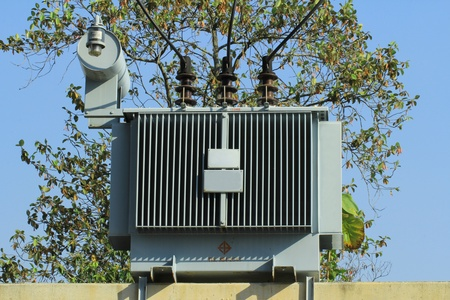 electricity substation: Electrical power transformer Stock Photo