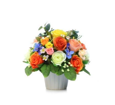 Colorful Artificial Flower Arrangement on white background photo
