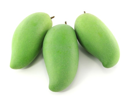 Green mangoes isolated on a white background  photo